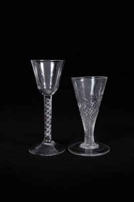 Lot 13-18th century wine glass, the round funnel bowl on an air twist stem, above a high pointed conical foot, together with an 18th century ale glass with wrythen stem (2)