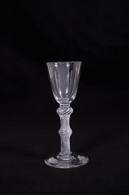 Lot 8-Georgian wine glass, with a round funnel bowl on a double-knopped multi-spiral air twist stem, above a conical foot, circa 1750, 15.5cm height