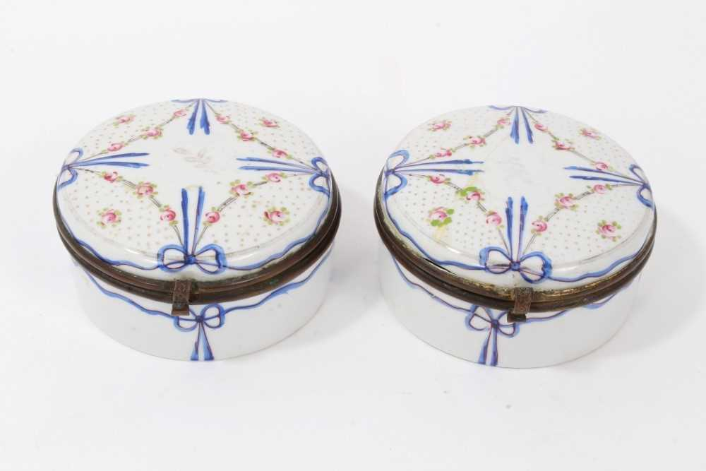 Lot 723-Pair of 19th century Continental enamelled circular boxes with metal mounts