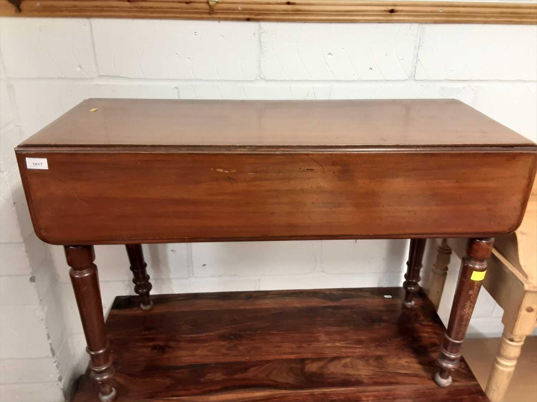 Lot 8-Victorian mahogany drop leaf table on turned legs