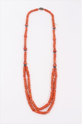 Lot 3-Old Chinese coral necklace, six of the barrel beads flanked by blue enamel flowers terminating with a double row of coral beads and an oval silver clasp