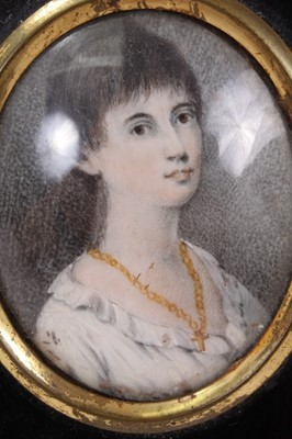 Lot 709-George III portrait miniature on ivory, together with another portrait miniature