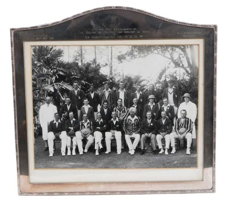 Lot 722-Of Cricket interest - silver mounted photo of an Indian cricket team, engraved dedication to Hubert Ashton from the Board of Control for Cricket in Indian Calcutta 1961