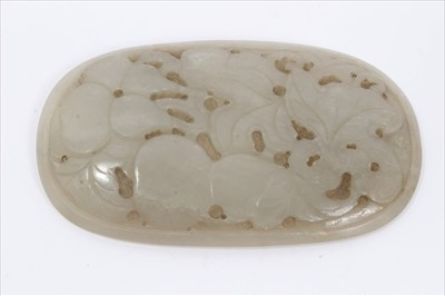 Lot 9-Chinese jade caved oval plaque with engraved leaf and fruit decoration
