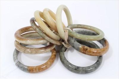 Lot 10-Ten jade/green hard stone polished bangles