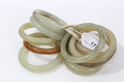 Lot 11-Ten jade/green hard stone polished bangles