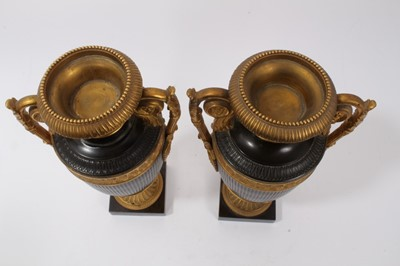 Lot 701-Pair of 19th century Grand Tour patinated bronze urns