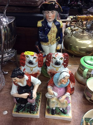 Lot 43-Staffordshire Toby jug in form of Nelson, pair spaniels, Darby and Joan figures