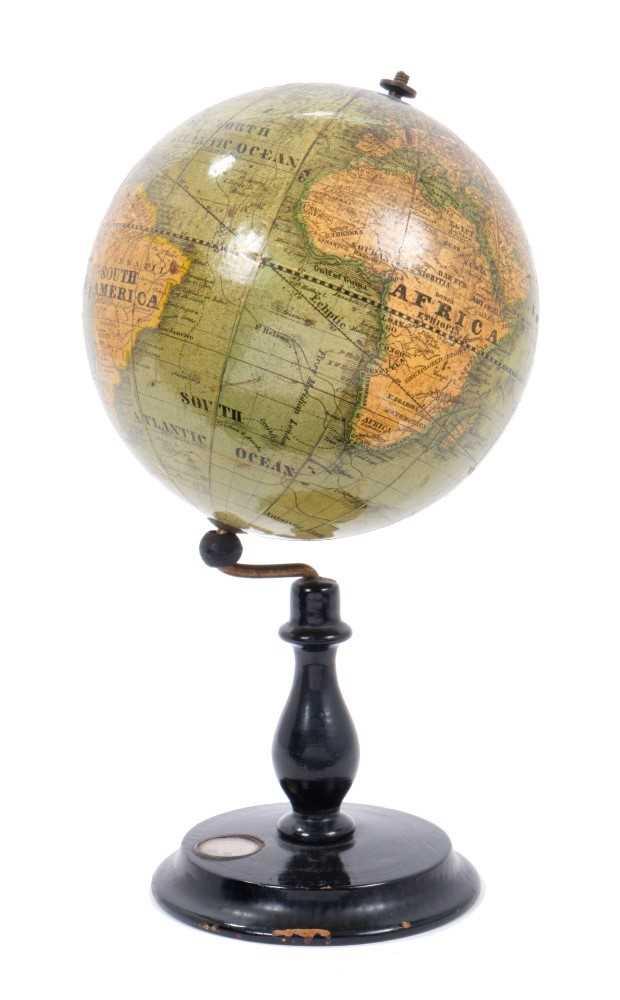 Lot 705-Late 19th century table globe