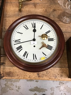 Lot 19-Victorian-style wall clock with white dial and Roman numerals