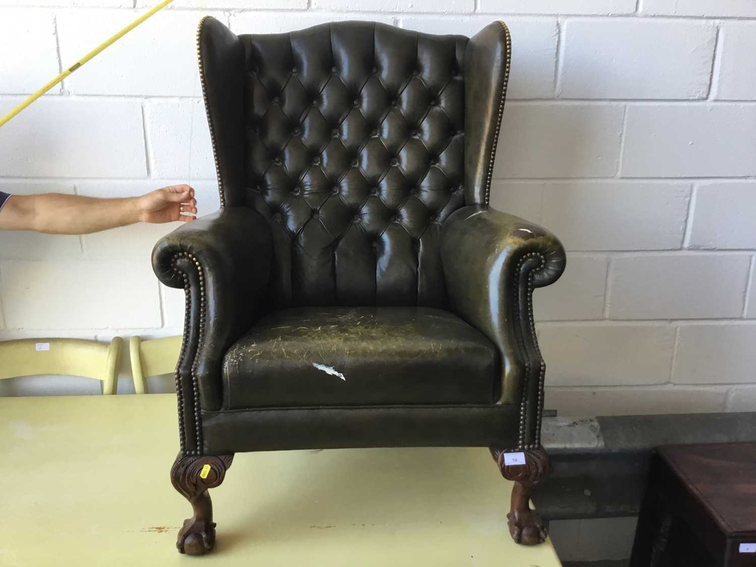 Lot 14-Leather button upholstered wingback armchair
