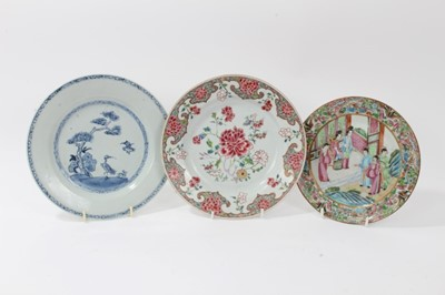 Lot 21-18th century Chinese famille rose porcelain plate, an 18th century Chinese blue and white plate, and a 19th century Canton plate (3)
