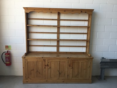 Lot 1-Antique pine two height dresser, with open shelves above with three panelled doors below, 215cm long, 227cm in overall length, 52cm deep