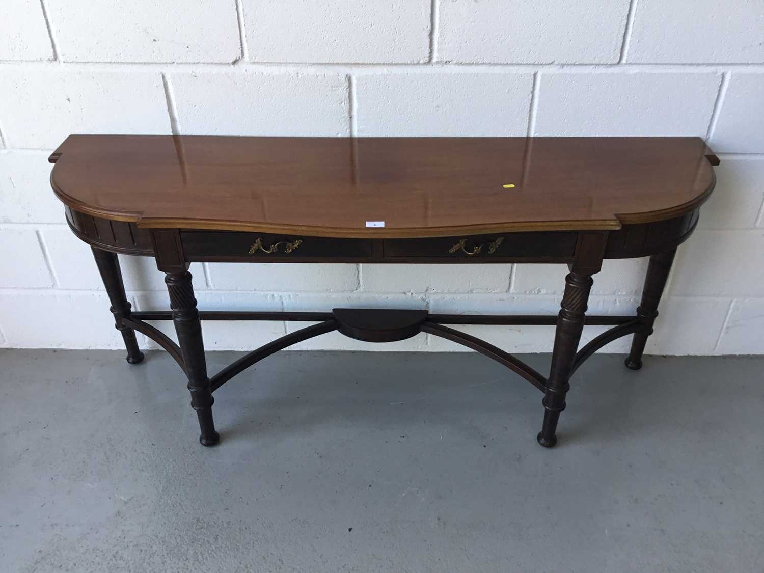 Lot 6-Edwardian Mahogany serpentine fronted console / hall table, two draws below, on turned legs with stretchers, 162cm width, 73cm height, 46cm depth