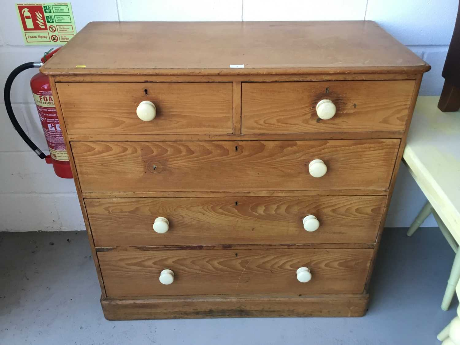 Lot 3-Victorian pine chest of draws, comprising two short and three long draws, with ceramic bun handles