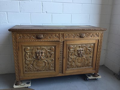 Lot 20-Edwardian heavily carved oak side board