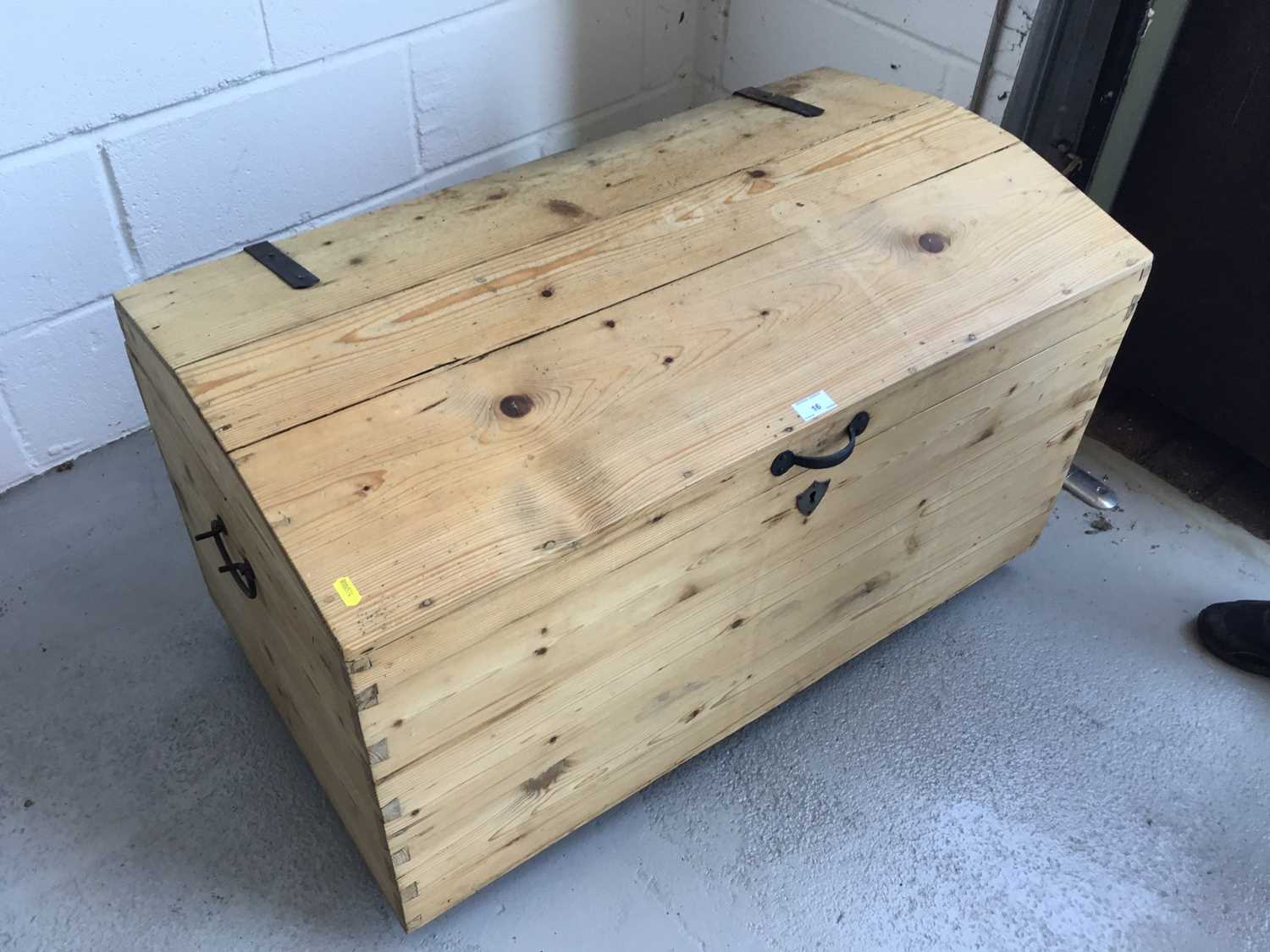 Lot 16-Antique pine dome topped trunk, with hinged lid and iron straps and handles, 94cm width, 55cm height, 53cm depth