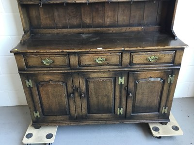 Lot 22-Manner of Titchmarsh & Goodwin- Good Quality reproduction oak two height dresser with raised panelled back, three draws and three panelled doors below, 137cm length, 187cm height, 46cm depth