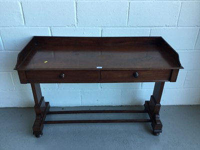 Lot 38-Victorian mahogany hall table with raised ledge back and sides, end standards joined by two stretchers on bun feet, 122cm in length, 82cm in height, 49cm depth