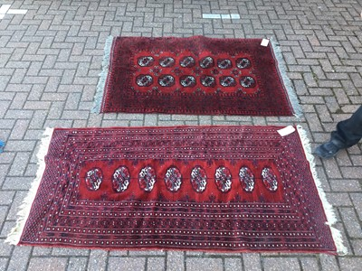Lot 43-Two Eastern Rugs with geometric decoration on red ground, 155 x 104cm and 178 x 91cm