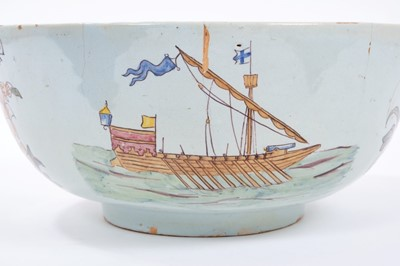 Lot 31-Unusual polychrome Delft ware bowl, commemorating Nelson, with ship and floral decoration, 29cm diameter