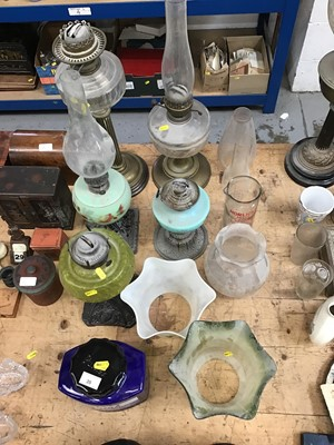 Lot 35-Group of five oil lamps together with shades and chimneys (qty)