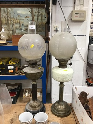 Lot 37-Two Victorian brass oil lamps, one with a milk glass reservoir (2)