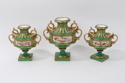 Lot 34-Garniture of three 19th century porcelain vases