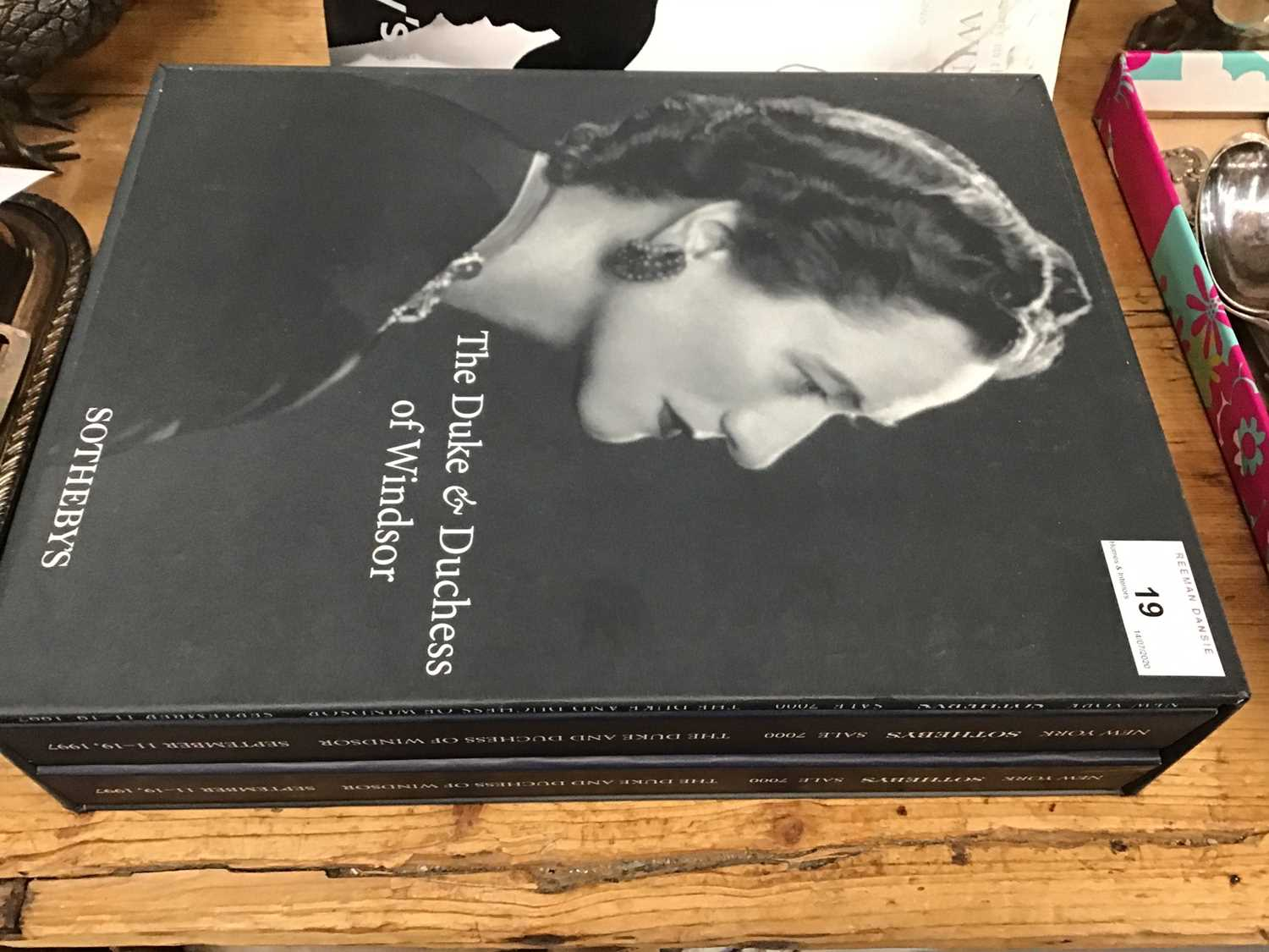 Lot 19-The Duke & Duchess of Windsor, Sothebys Sale catalogues in original slip case, Jewels of The Duchess of Windsor and the list of Wedding Presents to HM The Queen and Prince Philip