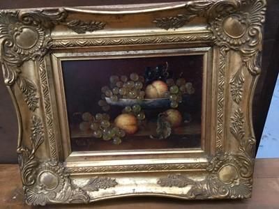 Lot 33-Pair of Continental school oils on panel - still life of fruit, indistinctly signed, in gilt frames