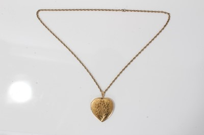 Lot 19-9ct gold large heart shaped locket on a yellow metal chain