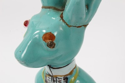 Lot 42-Unusual pottery figure, possibly of the March Hare, in a Galle style turquoise  glaze, 27cm height