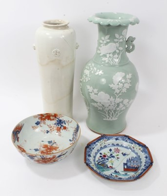 Lot 28-Antique Chinese ceramics, including a large 17th/18th century Dehua blanc de chine cylindrical vase with moulded masks and roundels, 40.5cm height, a 19th century celadon ground vase, an 18th centu...