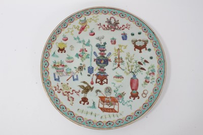 Lot 39-19th century Chinese famille rose porcelain dish, decorated with precious objects, ruyi pattern border, 34cm diameter