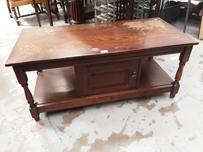 Lot 24 - Old Charm style oak coffee table with cupboard below 106cm wide, 50cm deep, 47cm high