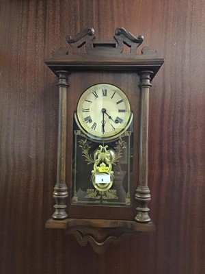 Lot 8-Oak hanging wall clock enclosed by glass frame with pendulum