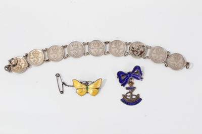 Lot 16-Silver and yellow guilloché enamel butterfly brooch, silver and enamel Royal Navy sweetheart brooch and a silver three-penny coin bracelet