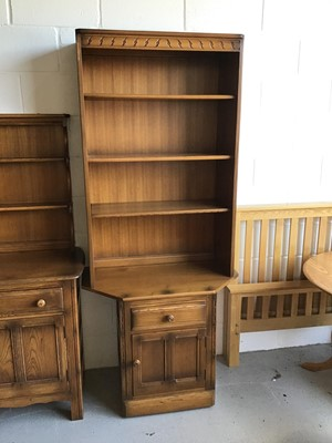 Lot 32 - Ercol elm two height bookcase with three opened shelves above single drawer and cupboard below H196.5cm W80cm D50cm