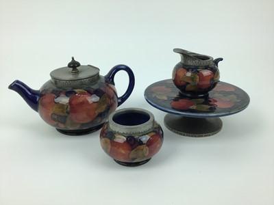 Lot 19-Group of Moorcroft pomegranate pewter mounted tablewares - teapot, milk jug, Tarza, rosebowl