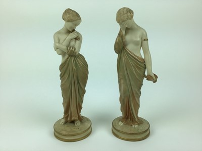Lot 22-Pair of Royal Worcester Blush ivory semi clad female figures