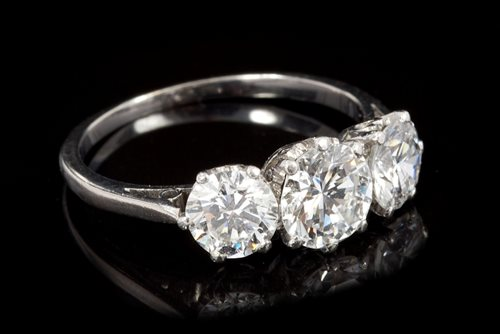 Lot 635-Fine diamond three-stone ring, with three...