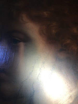 Lot 454 - 18th century, Italian School, oil on canvas - portrait of a young boy in profile, in ornate parcel gilt carved Florentine frame