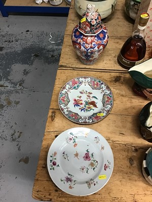 Lot 10-Two 18th century Chinese export porcelain plates together with a 19th century Japanese Imari vase and cover (3)