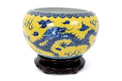 Lot 2 - Chinese porcelain bowl with dragon decoration on a yellow ground
