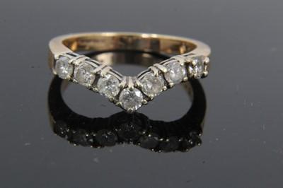 Lot 21 - 9ct gold diamond seven stone wishbone ring