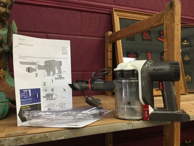 Lot 10-Dyson DC30 hand held vacuum cleaner together with manuals and accessories
