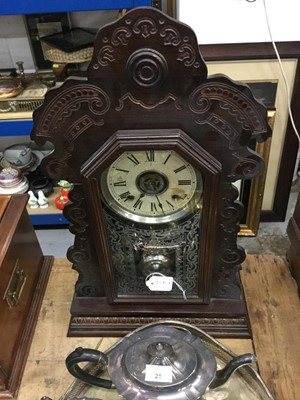 Lot 23-American mantel clock in carved wood case