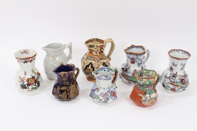 Lot 68 - A rare Masons Ironstone relief moulded jug, five other Masons jugs and two tooth brush vases