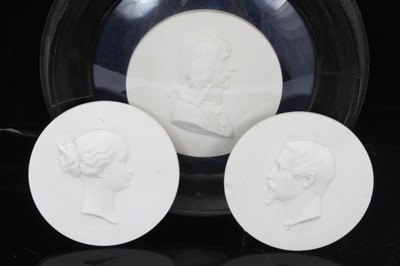 Lot 75 - Three 19th century Sevres biscuit porcelain round plaques