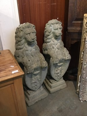 Lot 2-Pair of re-constituted stone lions